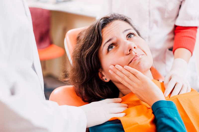 woman with toothache at dentist